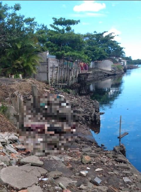 Corpo é encontrado às margens de rio na Baixada do Santos Dumont