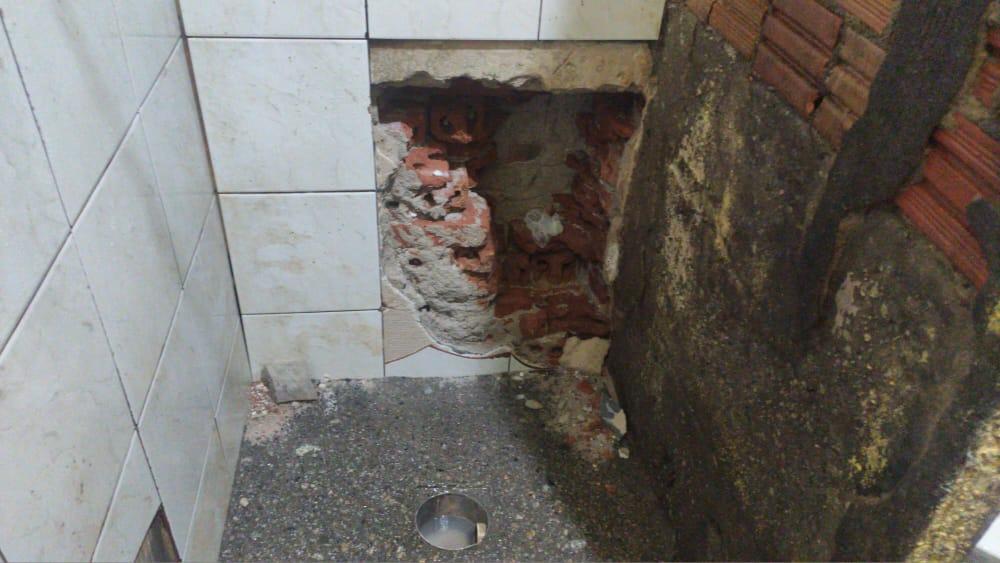 parede aberta para tentativa de fuga